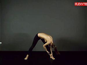 dark-haired gymnast showcasing of her bum