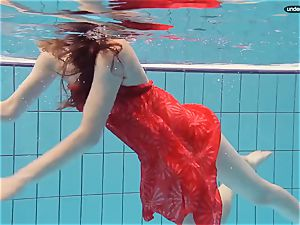 red clothed nubile swimming with her eyes opened