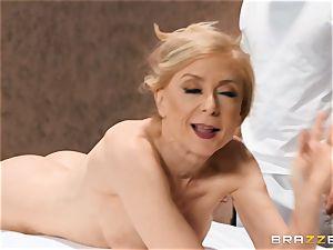 Mature Nina Hartley body massage