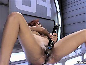 ebony shovs machine in vulva and arse