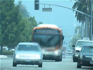 Karmen Bella pokes her boy on a crowded bus